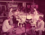 Pianist and nightclub guests at the Howell House Zebra Room, 1954