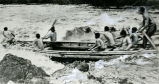 White-water canoe in rapids, 1930s?