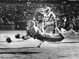 Atlanta Falcons' Rolland Lawrence dives for an interception, 1980