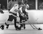 Atlanta Flames Tom Lysiak fights for the puck, 1978