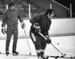 Atlanta Flames coach Bernie Geoffrion during practice with Rey Comeau, circa 1980s