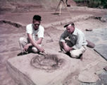 Archaeologist Lewis Larson uncovers a fireplace at the Etowah Indian Mounds dig site, 1958