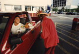 "Car hop ""Flossie Mae"" serves a customer at the drive-in portion of The Varsity, 1993"