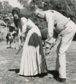 Film actress Audrey Hepburn, practicing golf on film-set with film director John Huston, Durango,...