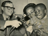 Child David Hunter yelps as Doctor William Likosky gives him a shot of the measles vaccine at the...