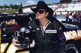 Falcons' coach Jerry Glanville attempts race car driving during the Busch Grand National circuit,...