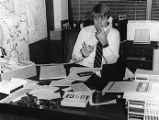 Retired Atlanta Flames Curt Bennett in his commercial real estate office, 1983