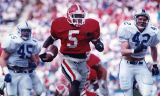 Georgia Bulldogs' Garrison Hearst outruns the Kentucky defense to score a touchdown, 1991