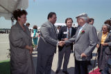 Mayor Maynard Jackson greets I.O.C. members boarding the Forbes yacht, 1990