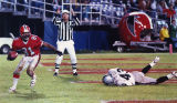 "Raiders' Sam Seale wipes out in the end zone after Falcons' Billy ""White Shoes"" Johnson..."