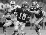 Atlanta Falcons' quarterback Chris Miller looks for an opening, 1988
