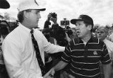 Bulldogs coach Ray Goff and Yellow Jackets coach Bobby Ross shake hands after UGA's defeat, 1990