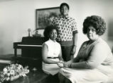 Civil rights pioneer, Mrs. Linda Brown Smith, with her two children Kimberley and Charles, Topeka,...