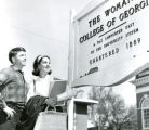 Bill McElheney and Cindy Richardson reading the sign marking the Woman's College of Georgia,...