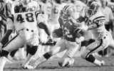 Falcons' quarterback Chris Miller being pursued by San Diego Chargers, 1988