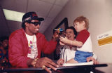 Atlanta Falcons' Deion Sanders donates time and money to Scottish Rite Childrens Hospital, 1989