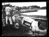 Wrecker hauling off a crashed race car at the Lakewood Speedway, Atlanta, Georgia, circa late...