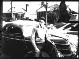 Young David Lennox Jr. with his Ford, Atlanta, Georgia, circa late 1930s or early 1940s