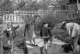 Inspecting the sandbox, Atlanta, Georgia, circa late 1930s or early 1940s