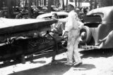 Speed boats being loaded on a trailer at Lake Guntersville, circa late 1930s or early 1940s