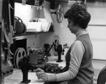 Woman operating a film editing station