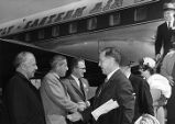 William B. Hartsfield, James M. Cox, Jr., and J. Leonard Reinsch greet guests at the airport