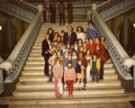 George Busbee and Cathey Steinberg with school children on the stairs of the state capitol,...