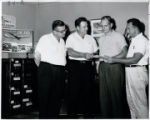 George Brown presenting settlement checks to members of District Lodge 100, 1960
