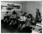 Apprentice class in classroom during test, 1964