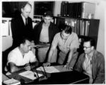 Eastern Air Lines Grievance Committee examining IAM Airline Division contract, circa 1950s