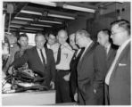 A. J. Hayes and other IAM officials observing hydraulic pumps testing at the Eastern air Lines...