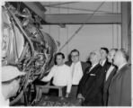 A. J. Hayes and other IAM officials observing J-75 jet engine repair at the Eastern air Lines...