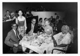 Participants of the Eastern Air Lines press trip to the Caribbean at dinner, circa 1970s