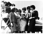 Publicity photo for Miss Atlanta Pageant of contestants boarding an Eastern Air Lines flight,...