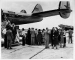 Press members and others preparing to board Eastern Air Lines inaugural flight to San Juan,...