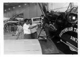 Aircraft mechanics viewing Eastern Air Transport Pitcairn Mailwing at 50th anniversary...