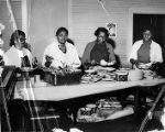 Tobacco workers union members preparing food for a party, circa 1950 or 1956.