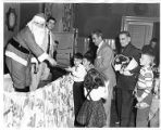 Santa Claus distributes gifts to children
