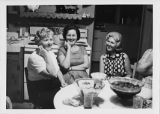 Three women sit around a kitchen table in Cartersville, Georgia.