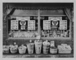 Exterior and window display at a Pender Grocery, 1933.