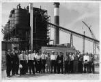 Robert Shadix in group outside factory.