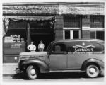 Teal Distribution Company truck and building, 1939.