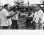 Claude Ramsay and three others discussing hurricane damage, August 22, 1969.