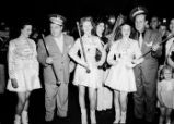 Comedians Abbot and Costello with drum majors