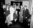 Jerry Lewis and Dean Martin (in bathrobes, left to right) with staff of Capitol Records...