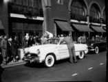 Davison-Paxon commissioned photographs of Easter Bunny getting out of convertible automobile. The...