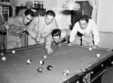 Off-duty soldiers shooting pool in an USO Service Men's Center, Atlanta, Georgia, 1942.