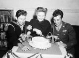 Wounded soldiers and sailors celebrating with a cake at a USO Service Men's Center, Atlanta,...