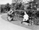 Soldier taking a photograph of a young lady, Atlanta, Georgia, 1946.