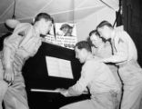 Soldiers playing the piano at a USO service center, Atlanta, Georgia, 1942